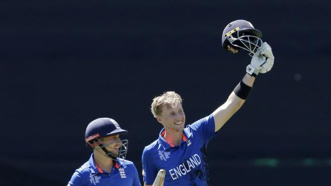 England's Taylor stands next to team mate Root who celebrates reaching his century during their Cricket World Cup match against Sri Lanka in Wellington