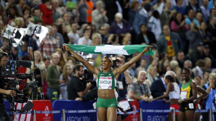 Nigeria's Blessing Okagbare celebrates winning the women's 100m final at the 2014 Commonwealth Games in Glasgow