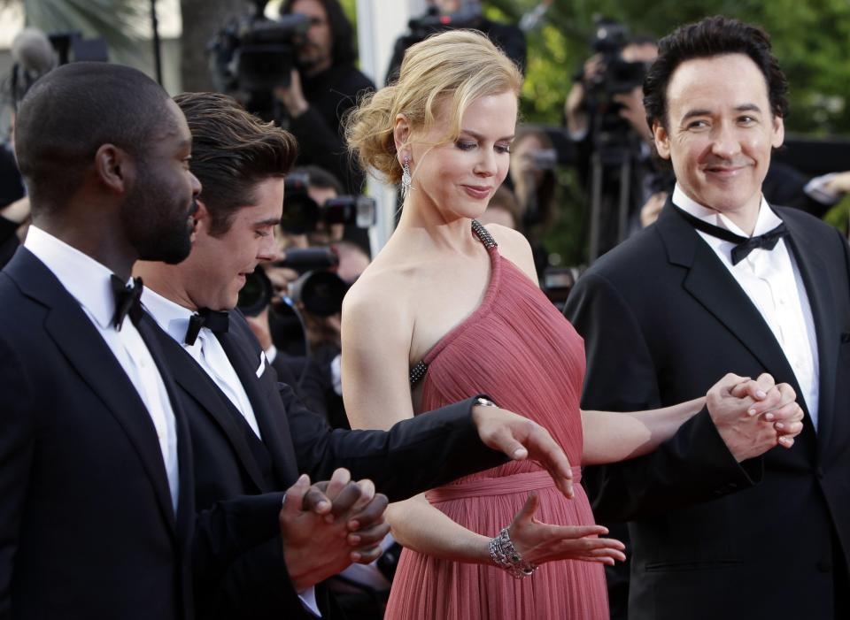 From left actors David Oyelowo, Zac Efron, Nicole Kidman and John Cusack arrive for the screening of The Paperboy at the 65th international film festival, in Cannes, southern France, Thursday, May 24, 2012. (AP Photo/Francois Mori)