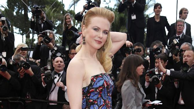"""FILE - This May 19, 2013 file photo shows actress and jury member Nicole Kidman wearing an embroidered L'Wren Scott dress for the screening of the film """"Inside Llewyn Davis"""" at the 66th international film festival, in Cannes. (Photo by Joel Ryan/Invision/AP, file)"""