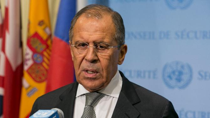 Russia Foreign Minister Sergey Lavrov speaks to the media after a meeting concerning Syria with US Secretary of State John Kerry at the United Nations headquarters in New York on September 30, 2015
