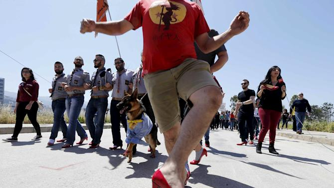 "Men wearing high-heeled shoes take part in a march to protest against sexual violence against women in a fundraising event called ""Walk A Mile In Her Shoes"" in Beirut"