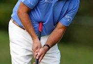 Phil Mickelson attempts a putt with a belly putter during the Deutsche Bank Championship in Norton, Massachusetts in 2011. &quot;Anchored&quot; putting, whereby the club is pivoted by a player&#39;s belly or chest, is set to be outlawed by 2016, world golf&#39;s two law-making bodies announced Wednesday
