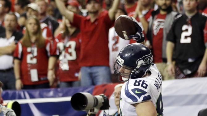 Seattle Seahawks tight end Zach Miller (86) spikes the ball after his touchdown catch against the Atlanta Falcons during the second half of an NFC divisional playoff NFL football game Sunday, Jan. 13, 2013, in Atlanta. (AP Photo/David Goldman)