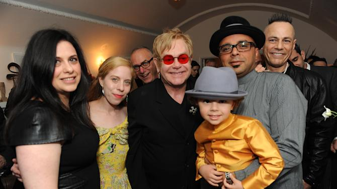 """Elton John and the cast of """"How to Survive a Plague"""" attend LoveGold/EJAF Celebrate """"How to Survive a Plague"""" at Chateau Marmont on February 22, 2013 in Los Angeles. (Photo by Jordan Strauss/Invision for LoveGold/AP Images)"""