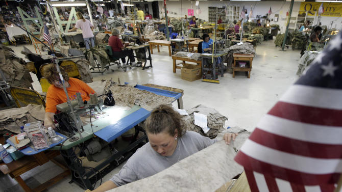 """In this Wednesday, Oct. 10, 2012 photo, apparel worker Misti Keeton sews military apparel in Fayette, Ala. Her employer, American Power Source, is laying off about 50 workers at her plant and another one in Columbus, Miss., after losing a contract to make Air Force exercise garb to Unicor. """"I'm terrified,"""" Keeton said. """"I've got two teenagers at home. I don't know what I'm supposed to say to them if I lose this job. I don't know what I'm supposed to feed them."""" (AP Photo/Dave Martin)"""