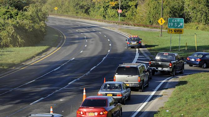 Westbound traffic is diverted off the Southern State Parkway at exit 19, Peninsula Blvd. in Rockville Centre due to a car accident that occurred early Monday, Oct. 8, 2012, on the Southern State Parkway westbound near exit 17 Hempstead Avenue on in West Hempstead, N.Y. New York State police say four people were killed in the one-car accident, and a fifth person was taken to a hospital. (AP Photo/Kathy Kmonicek)