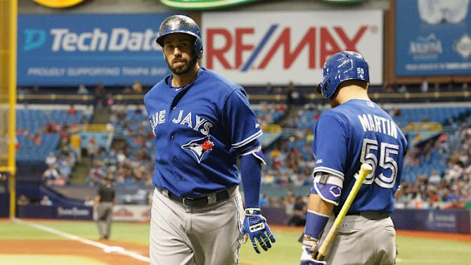 Chris Colabello (L) of the Toronto Blue Jays celebrates his home run with teammate Russell Martin during the fourth inning of their game against the Tampa Bay Rays, at Tropicana Field in St. Petersburg, Florida, on October 4, 2015