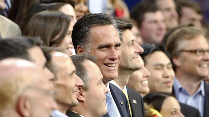 Republican presidential nominee Mitt Romney and Republican vice presidential nominee, Rep. Paul Ryan pose for a group picture with their campaign staff at the Republican National Convention in Tampa, Fla., on Thursday, Aug. 30, 2012. (AP Photo/Jae C. Hong)