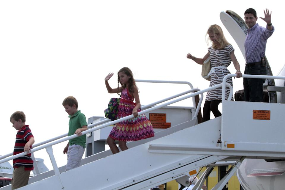 Republican vice presidential candidate, Rep. Paul Ryan, R-Wis.,  follows his family upon their arrival at Tampa International Airport in Tampa, Fla.,Tuesday, Aug. 28  ,2012. From left are, sons Charlie and Sam, daughter Liza and wife Janna.  (AP Photo/Mary Altaffer)