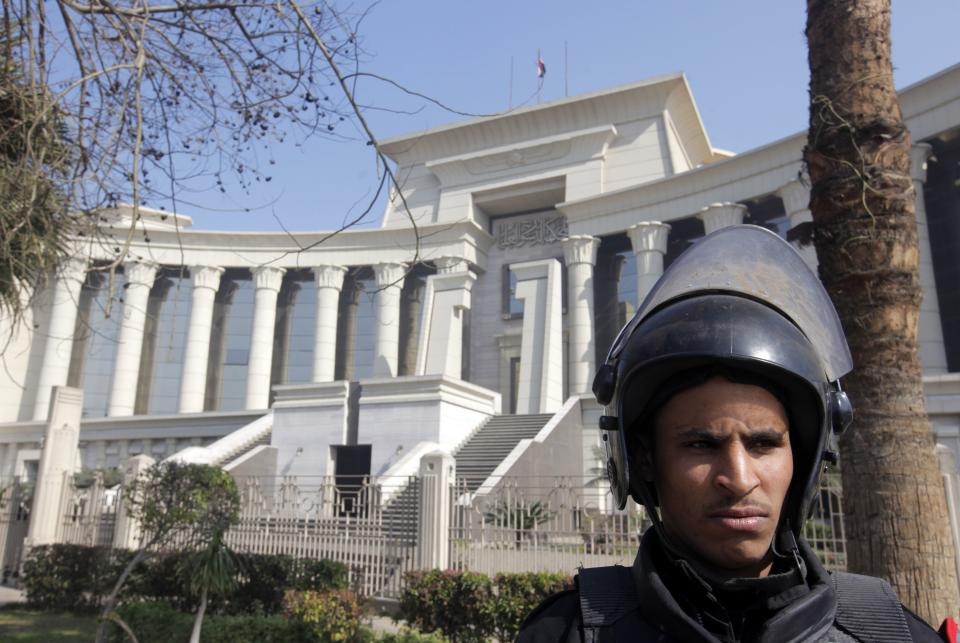 An Egyptian anti-riot soldier stands guard in front of the high constitutional court in Cairo, Egypt, Sunday, Feb. 3, 2013. The Court which was to rule on the legitimacy of Egypt's constituent assembly has postponed the verdict until March 3, 2013. (AP Photo/Amr Nabil)