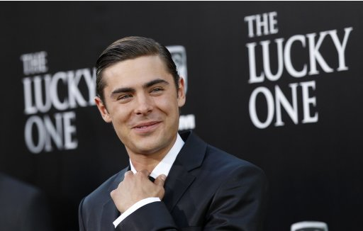 "Filr photo of cast member Efron poses at the premiere of ""The Lucky One"" at the Grauman's Chinese theatre in Hollywood"