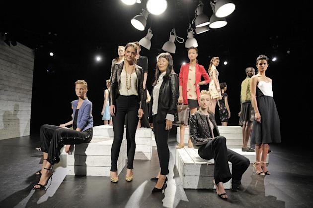 In this photo provided by Holmes & Yang,  Katie Holmes, center left, and Jeanne Yang, center right, pose for a portrait in front of the Holmes & Yang Spring 2013 collection during Fashion Week in New