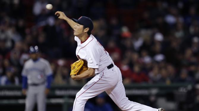 Boston Red Sox relief pitcher Koji Uehara delivers during the ninth inning of a baseball game against the Toronto Blue Jays at Fenway Park in Boston, Monday, April 27, 2015. (AP Photo/Charles Krupa)