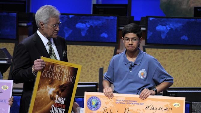 National Geographic Bee host Alex Trebek stands with National Geographic Bee champion Rahul Nagvekar, 14, from Quail Valley Middle School in Missouri City, Texas, Thursday, May 24, 2012, in Washington, . (AP Photo/Susan Walsh)