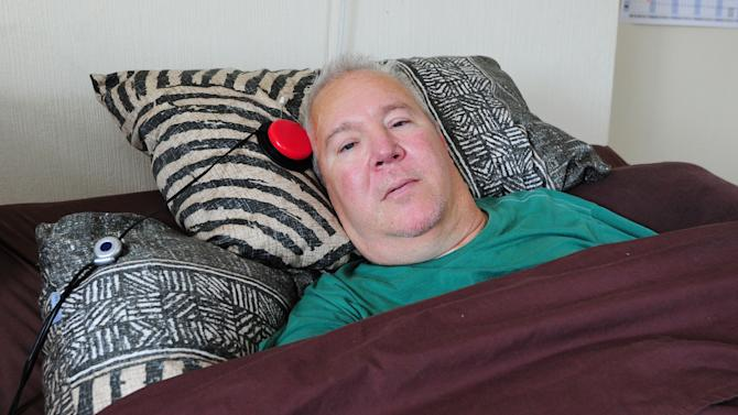 """Paralysed road accident victim Paul Lamb, lies in a bed at his home in Leeds, northern England Wednesday July 31, 2013. A British appeals court on Wednesday July 31, 2013 upheld a law against euthanasia in rejecting appeals from two severely disabled men who argued that doctors should be allowed to legally kill them. In a unanimous ruling, the judges said the two men had """"permanent and catastrophic physical disabilities"""" but said the issue of euthanasia """"raises profoundly sensitive questions about the nature of our society."""" The judges wrote that """"Parliament represents the conscience of the nation"""" and said the court had no jurisdiction to challenge the legal ban on euthanasia. """"I am absolutely gutted,"""" said Paul Lamb, one of the men involved, who was severely paralyzed after a car accident. (AP Photo/Anna Gowthorpe/PA) UNITED KINGDOM OUT"""