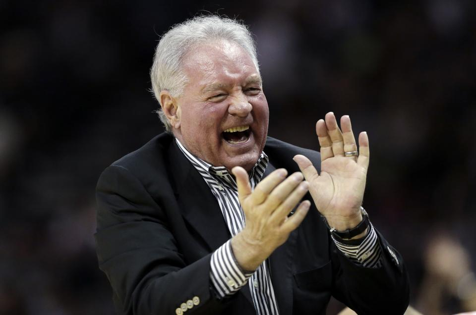 San Antonio Spurs owner Peter Holt cheers during the first half in Game 1 of a Western Conference Finals NBA basketball playoff series against the Memphis Grizzlies, Sunday, May 19, 2013, in San Antonio. (AP Photo/Eric Gay)