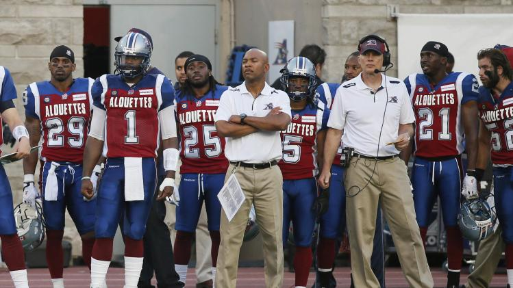 Montreal Alouettes' starting quarterback Troy Smith watches from the sidelines during first half CFL football action against Toronto Argonauts in Montreal