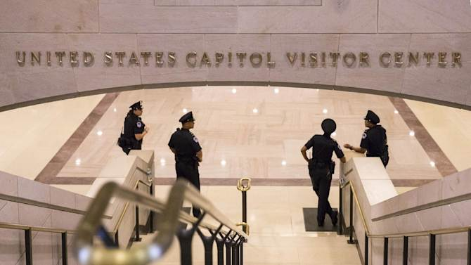 Normally packed with tourists, the stairs leading from the Capitol Visitors Center up to the Capitol Rotunda are empty as the government shutdown enters a second week, Monday, Oct. 7, 2013, in Washington. The government partially shut down last week amid Washington gridlock and faces a make-or-break deadline later this month about the nation's borrowing power. Republicans have refused to budge without concessions on Democrats' health care law. Democrats have resisted GOP efforts to dismantle that health care law. (AP Photo/J. Scott Applewhite)