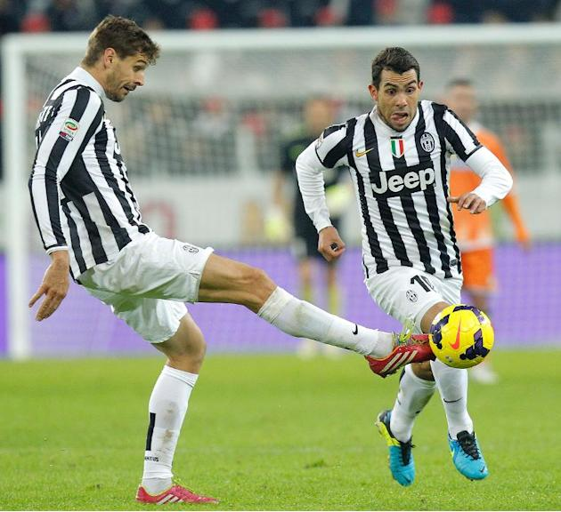 Juventus' Fernando Llorente passes the ball to Carlos Tevez during their Italian Serie A match against Udinese, at Juventus Stadium in Turin, on December 1, 2013