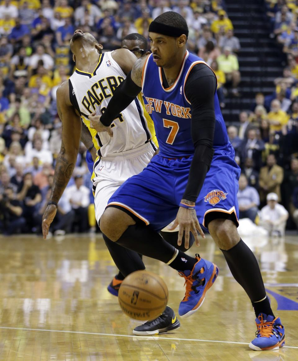 New York Knicks' Carmelo Anthony (7) drives past Indiana Pacers' Paul George during the first half of Game 4 of an Eastern Conference semifinal NBA basketball playoff series on Tuesday, May 14, 2013, in Indianapolis. (AP Photo/Darron Cummings)