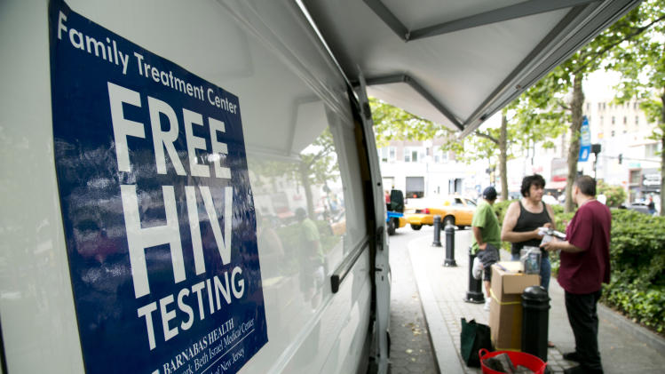"Free HIV tests are offered as part of the Condom Nation tour on Friday, June 1, 2012 in Jersey City, NJ. The AIDS Healthcare Foundation launched a ""Condom Nation"" tour to help promote condom use in an effort to reduce the HIV/AIDS infection rate. The initiative, which also involves free screenings and education sessions, spans 20 states during a six-month nationwide tour. (Charles Sykes /AP Images for AIDS Healthcare Foundation)"