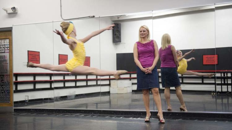 "Christi watches with a close eye as her daughter Chloe glides through the air in ""Dance Moms."""