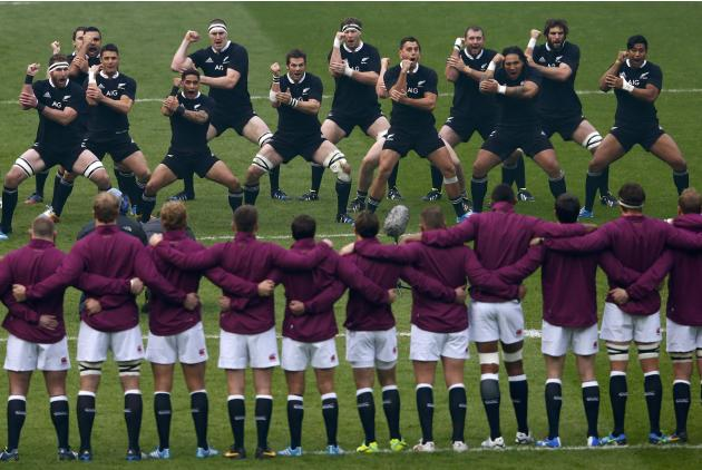 England's players (bottom) look on as New Zealand's players perform the Haka before their international rugby union match at Twickenham in London