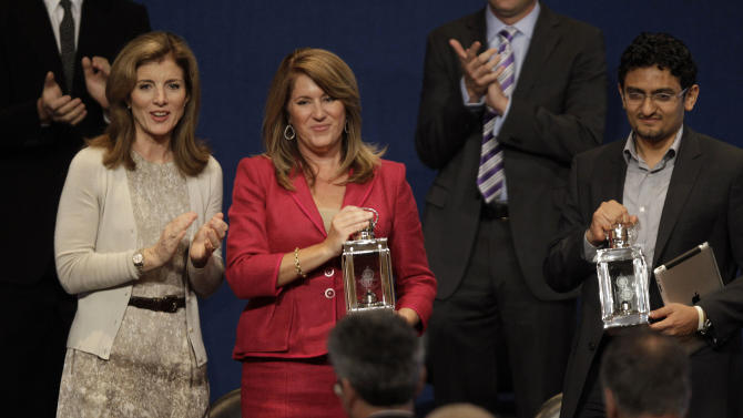 Caroline Kennedy, left, applauds recipients of the John F. Kennedy Profiles in Courage Award, Elizabeth Redfenbaugh, center and Egyptian Wael Ghonim, right, at the JFK Library & Museum in Boston, Monday morning, May 23, 2011. Ghonim's Facebook page played a role in organizing the protests that led to the ouster this year of former Egyptian President Hosni Mubarak.   Redenbaugh, elected to the New Hanover County, N.C. school board in 2008, stood in opposition to a redistricting plan she feared would lead to racial segregation of middle schools. (AP Photo/Stephan Savoia)