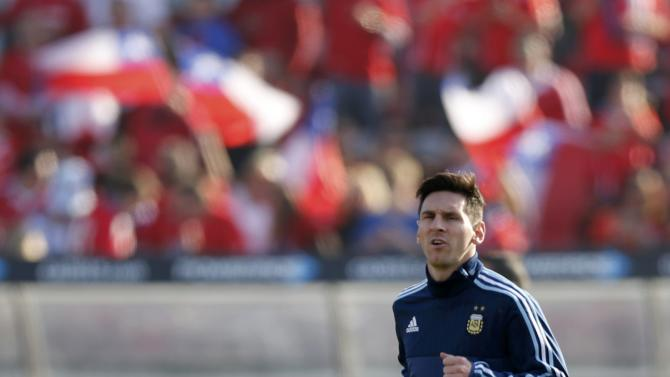 Argentina's Lionel Messi warms up ahead of the Copa America 2015 final soccer match against Chile at the National Stadium in Santiago
