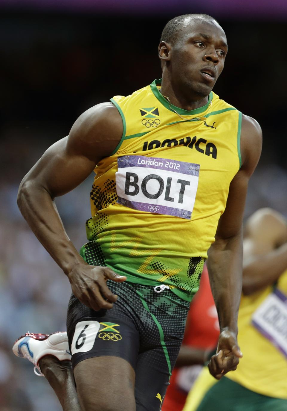 Jamaica's Usain Bolt competes in a men's 200-meter semifinal during the athletics in the Olympic Stadium at the 2012 Summer Olympics, London, Wednesday, Aug. 8, 2012. (AP Photo/Ben Curtis)