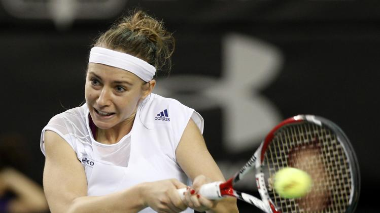 Slovakia's Kucova plays a shot against Canada's Bouchard during their Fed Cup tennis match in Quebec City