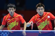 China&#39;s Wang Hao (R) and Zhang Jike return a ball to South Korea&#39;s Oh Sangeun and South Korea&#39;s Ryu Seungmin during the table tennis men&#39;s team final China vs South Korea at the London Olympic games on August 8, 2012 at the Excel arena in London.      AFP PHOTO / SAEED KHAN