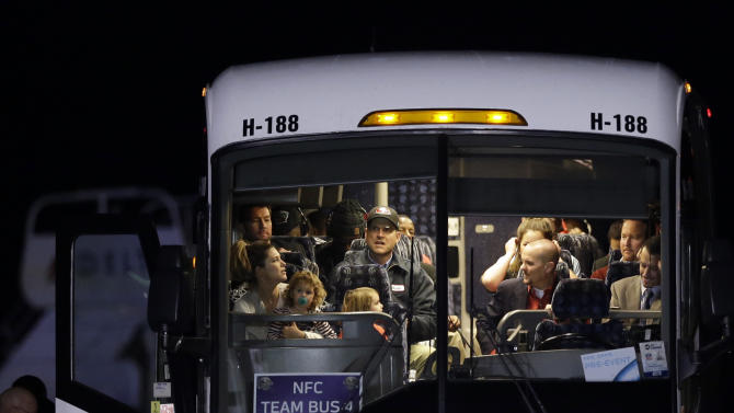 San Francisco 49ers head coach Jim Harbaugh makes a face on the team bus after arriving at the Louis Armstrong International Airport for the NFL Super Bowl XLVII football game Sunday, Jan. 27, 2013, in New Orleans. (AP Photo/Pat Semansky)