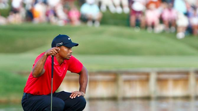 May 12, 2013; Ponte Vedra Beach, FL, USA; Tiger Woods lines up his putt on the 17th green in the final round of The Players Championship at TPC Sawgrass - Stadium Course. (Debby Wong-USA TODAY Sports)