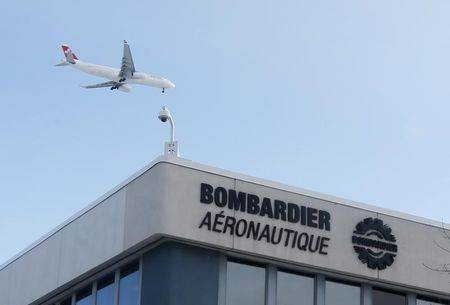 buA plane flies over a Bombardier plant in Montreal
