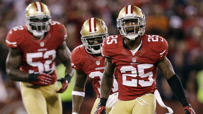 San Francisco 49ers cornerback Tarell Brown (25) celebrates with linebacker Patrick Willis (52) and safety Donte Whitner (31) after intercepting a pass from Chicago Bears quarterback Jason Campbell during the second quarter of an NFL football game in San Francisco, Monday, Nov. 19, 2012. (AP Photo/Marcio Jose Sanchez)