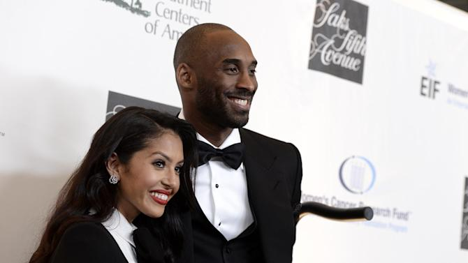"""Los Angeles Lakers guard Kobe Bryant, right, and his wife Vanessa Bryant arrive at """"An Unforgettable Evening"""" benefiting EIF's Women's Cancer Research Fund at The Beverly Wilshire on Thursday, May 2, 2013, in Beverly Hills, Calif. (Photo by Dan Steinberg/Invision/AP)"""