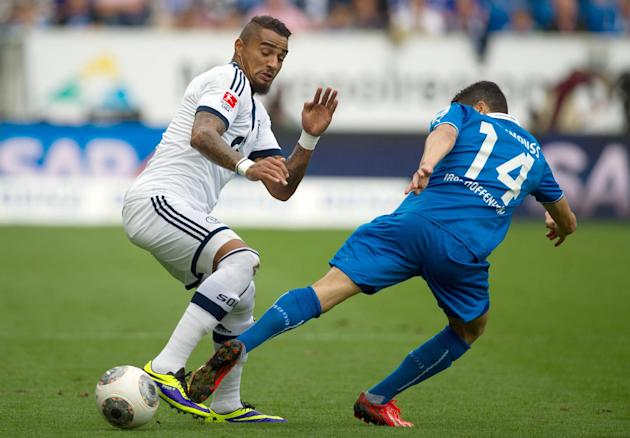 Schalkes Kevin-Prince Boateng, left, and Hoffenheim's Tarik Elyounoussi challenge for the ball during the German first division Bundesliga soccer match between TSG 1899 Hoffenheim and Schalke 04 in Si