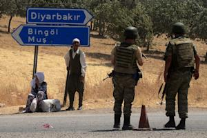 Turkish soldiers wait at a check point in Diyarbakir…