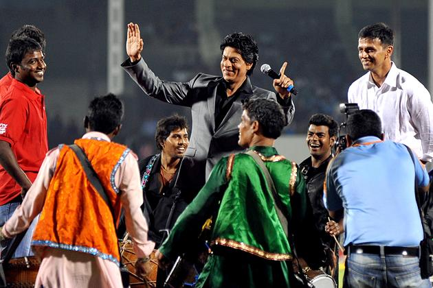 Indian Bollywood actor Shah Rukh Khan (C) and former Indian cricketer Rahul Dravid (R) launch the grand opening ceremony of the Toyota University Cricket Championship (TUCC) first match of the season