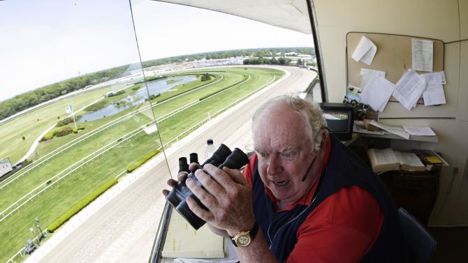 """FILE - In this May 26, 2008, file photo, Belmont Park track announcer Tom Durkin looks down at the homestretch while calling the first hose race of the day at Belmont Park in New York. After two decades or so as the signature voice for the sport's premier events, but more sleepless nights and anxious moments than he could bear, Durkin simply said, """"enough."""" (AP Photo/Julie Jacobson, File)"""