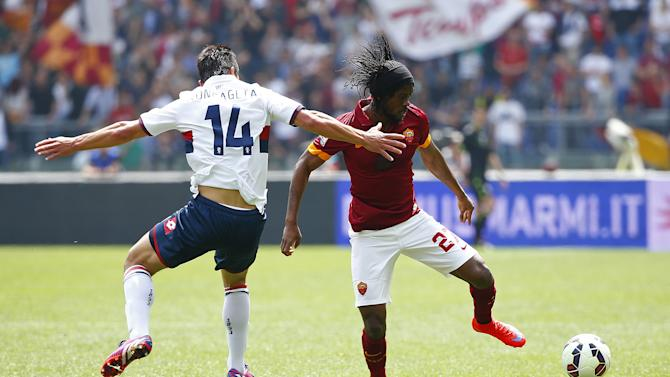 AS Roma's Gervinho is challenged by Genoa's Roncaglia during their Italian Serie A soccer match at the Olympic stadium in Rome
