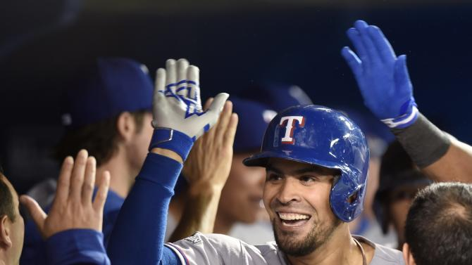 Texas Rangers' Robinson Chirinos is congratulated on his two-run home run against the Toronto Blue Jays at the top of the fifth inning of baseball Game 1 of the American League Division Series in Toronto on Thursday, Oct. 8, 2015. (Frank Gunn/The Canadian Press via AP) MANDATORY CREDIT