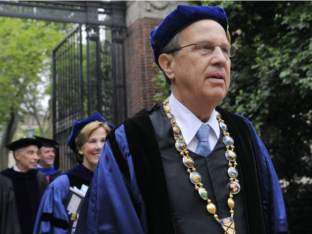 FILE - In this May 21, 2012 file photo, Yale University president Richard Levin, right, leads a procession during Yale's commencement exercises in New Haven, Conn. Levin, 65, announced Thursday, Aug. 