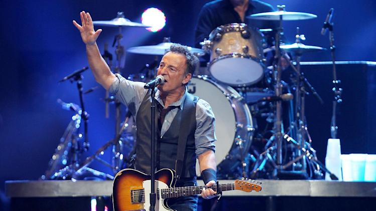 This image released by Starpix shows Bruce Springsteen performing at the 12-12-12 The Concert for Sandy Relief at Madison Square Garden in New York on Wednesday, Dec. 12, 2012. (AP Photo/Starpix, Dave Allocca)