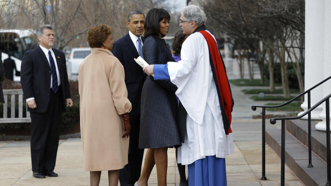 First lady Michelle Obama is greeted by Rev. Luis Leon at St. John's Church in Washington, Monday, Jan. 21, 2013, as the first family arrived for a church service during the 57th Presidential Inauguration. (AP Photo/Jacquelyn Martin)
