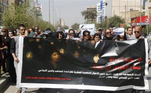 "Iraqi Protesters hold banner during a demonstration against the draft of the ""Al-Jafaari"" Personal Status Law during International Women's Day in Baghdad"