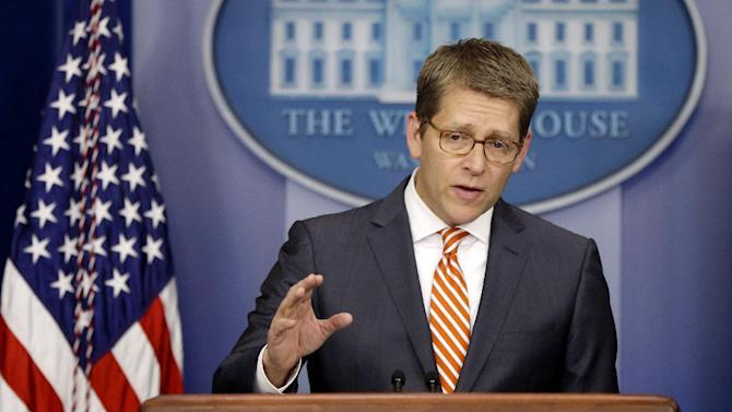 White House Press Secretary Jay Carney gestures as he briefs reporters at the White House in Washington, Tuesday, Dec. 4, 2012.(AP Photo/Charles Dharapak)