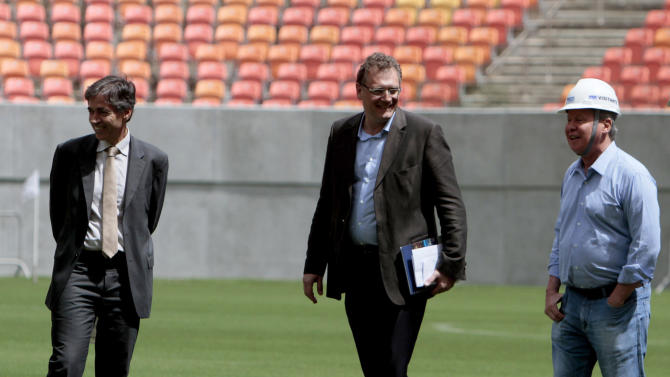 FIFA Secretary General Jerome Valcke, center, Brazil's Executive Secretary of the Ministry of Sports Luis Fernandes, left, and Manaus Mayor Arthur Virgilio Neto, are seen during an inspection tour of Arena da Amazonia stadium in Manaus, Brazil, Sunday, Feb. 16, 2014. The Arena da Amazonia is one of the stadiums still under construction for the World Cup which starts in June. (AP Photo/Alberto Cesar Araujo)